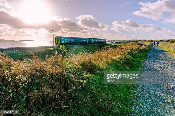 train passing the welsh coastline - ラネリー ストックフォトと画像