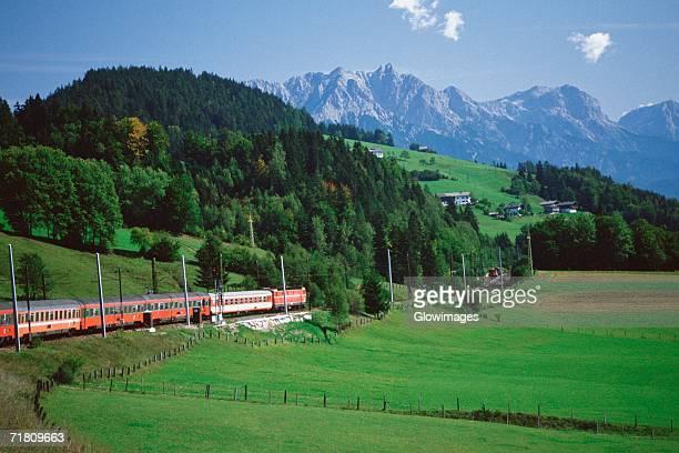 train passing through a hillside, innsbruck, austria - innsbruck stock pictures, royalty-free photos & images