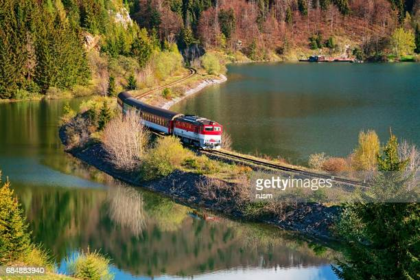 Train passing through lake near Mlynky village in the Slovak Paradise (Slovensky raj) national park, Slovakia.