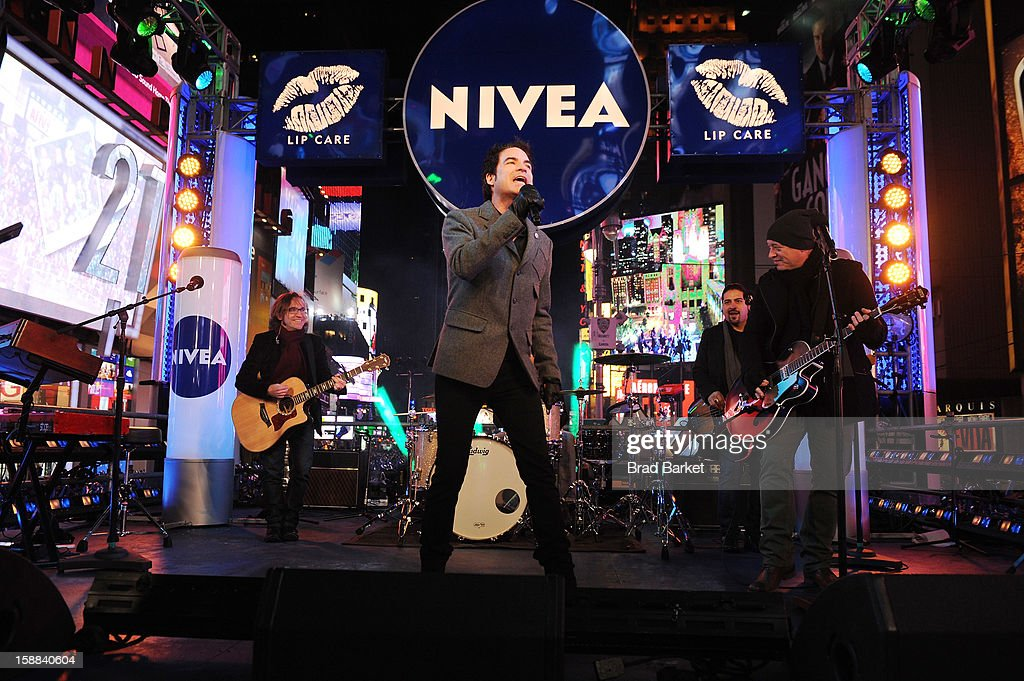 Train performs 'Mermaid' on the NIVEA Kiss Stage in Times Square on New Year's Eve 2013 at Times Square on December 31, 2012 in New York City.