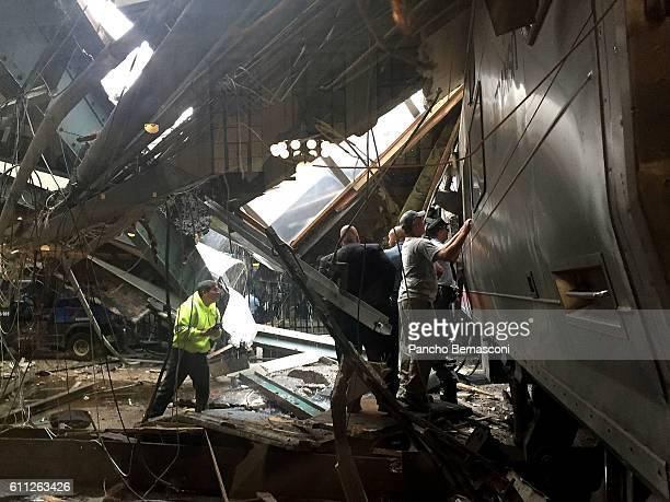 Train personel survey the NJ Transit train that crashed in to the platform at the Hoboken Terminal September 29 2016 in Hoboken New Jersey New Jersey...
