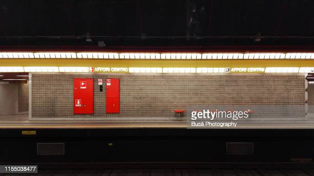 train platform inside milan subway station, italy - subway station stock pictures, royalty-free photos & images