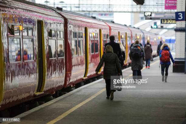 train platform, waterloo station, london - carrying stock pictures, royalty-free photos & images