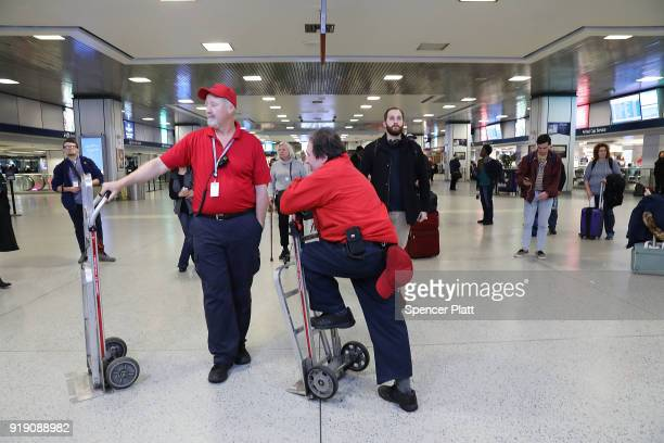 Train porters rest at New York's Pennsylvania Station on February 16 2018 in New York City Amtrak gave a media tour on Friday to show the progress...