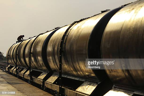 Train pulling water tankers stands at Latur railway station in Latur, Maharashtra, India, on Saturday, April 16, 2016. Hundreds of millions of people...
