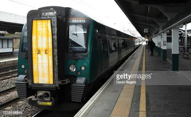 Train pulls in to a near deserted Northampton station on March 19, 2020 in Northampton, United Kingdom. People have been encouraged to work from home...