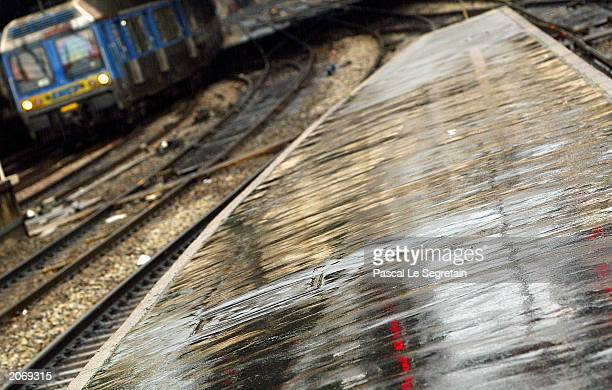 A train pulls up to an empty platform of Saint Lazare railway station June 10 2003 in Paris France Train services across France have been heavily...