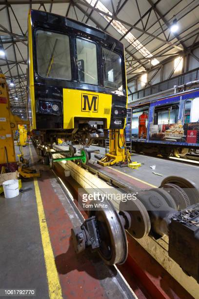 A train receives repair work at the Tyne and Wear Metro depo on November 15 2018 in Gosforth England Staff work around the clock at the century old...