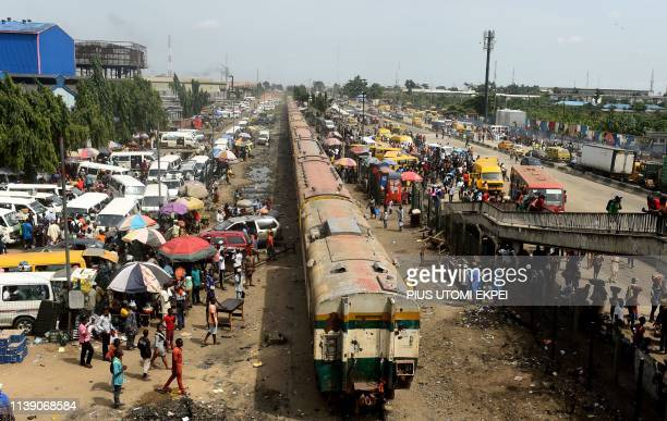 Train rolls past the newly built multi-storey mega bus terminal, Oshodi Transport Interchange, Nigeria's busiest transport interchange, with over 13...