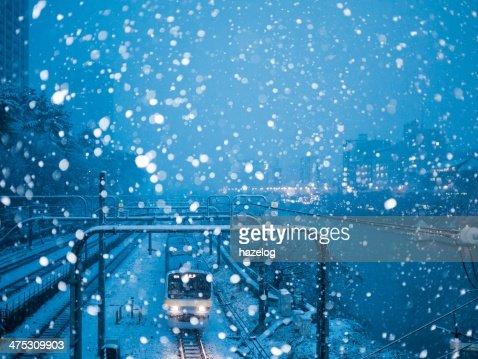 Train running in heavy snow night