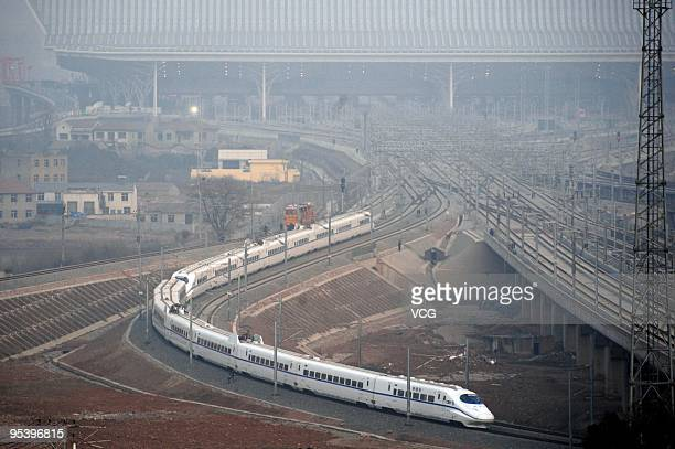 A CRH train runs out of the Wuhan Railway Station on December 26 2009 in Wuhan Hubei Province of China The WuhanGuangzhou highspeed railway which...