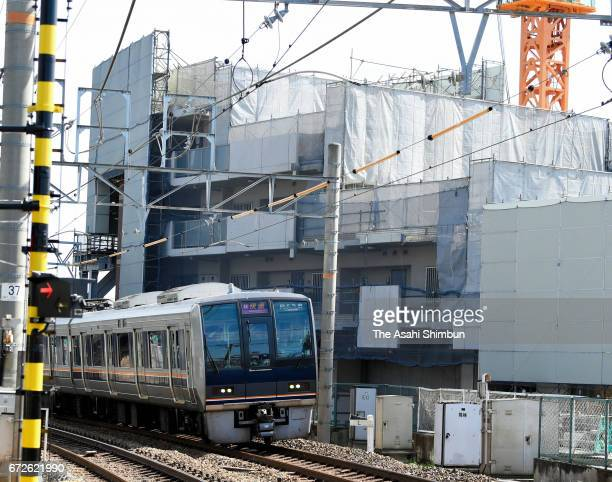 A train runs past the accident site on the twelveth anniversary of the train derailment accident on April 25 2017 in Amagasaki Hyogo Japan The worst...