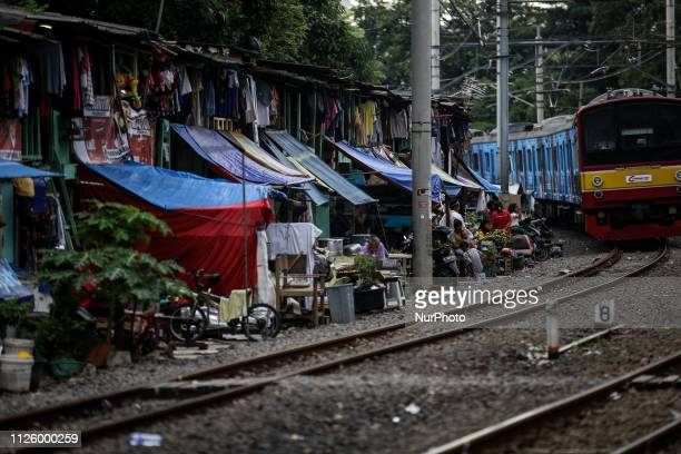 A train runs through a slum area at Jakarta Indonesia on February 20 2019