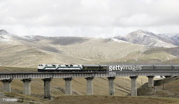 A train runs through the Kunlun Mountains the first train from Golmud Qinghai province to Tibet on July 2 2006 in Lhasa Tibet China