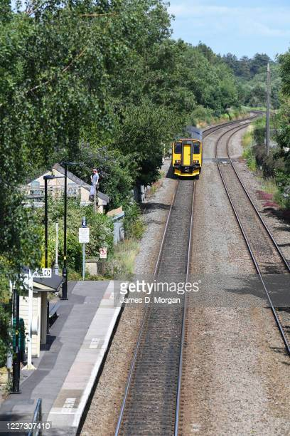 A UK train service of one carriage runs near Avoncliff railway station on July 18 2019 in Avoncliff England