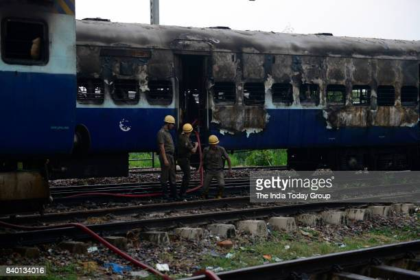 Train set afire at Anand Vihar railway station by Gurmeet Ram Rahims supporters in New Delhi.
