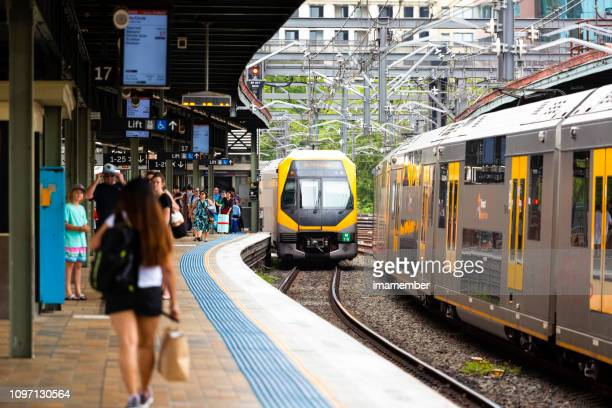 train staion with passengers and trains getting in and out of the train staion - public transport stock pictures, royalty-free photos & images
