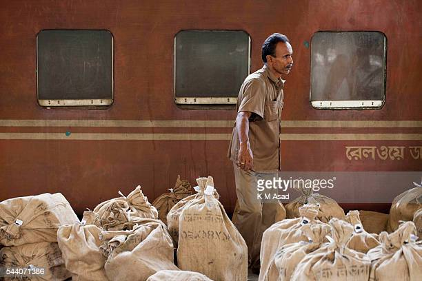 A train station post master collect bags of letters at Kamlapur railway station in Dhaka