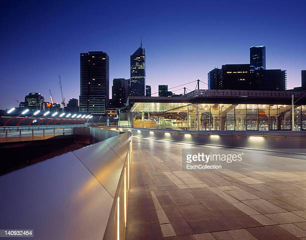 Train station with Melbourne skyline at dawn