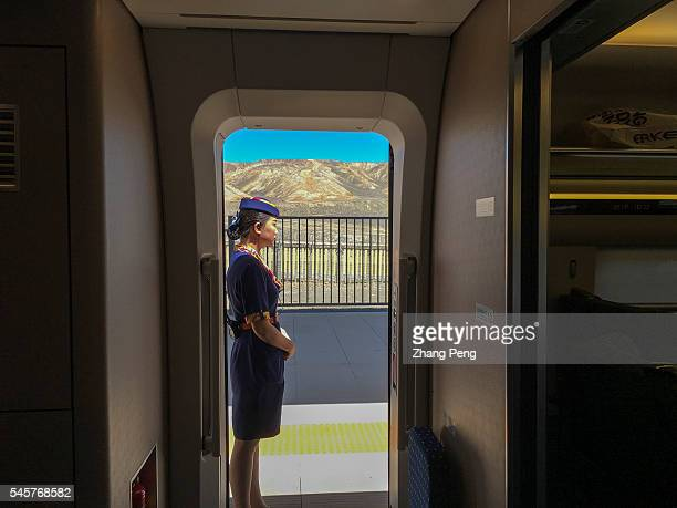 CRH train stops at Turpan North station waiting for passengers boarding The LanzhouXinjiang HighSpeed Railway also known as Lanxin Railway a...