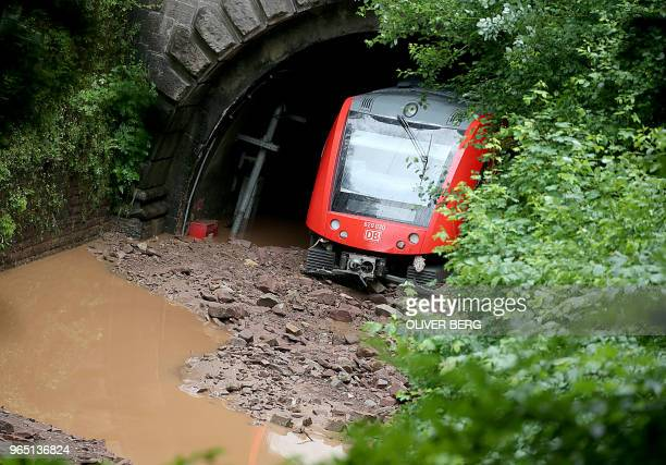 TOPSHOT A train stucks in a tunnel after heavy rainfall flooded rails in Wilsecker near Kyllburg western Germany on June 1 2018 / Germany OUT