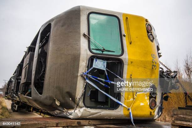 A train that derailed on February 18 is pictured before being towed from the railroad track at the site of the accident in KeseelLo Leuven on...