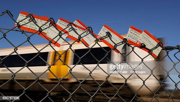 Train tickets which were placed in a fence in front of a train passing through Ashford in Kent as the annual rise in rail fares has been described by...