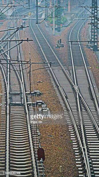 train track and catenary - metra train stock photos and pictures