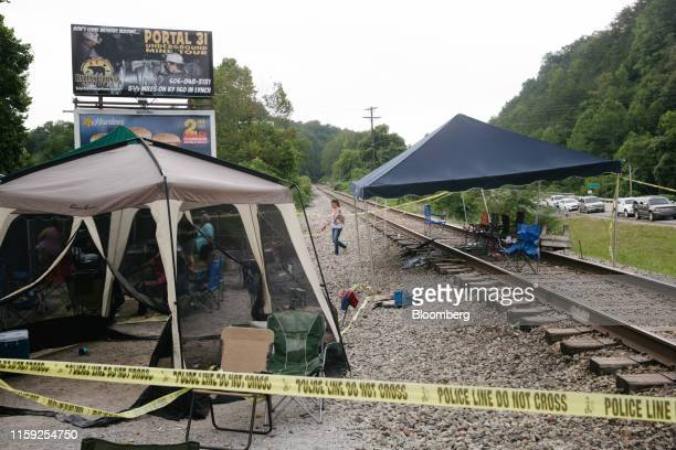 Train tracks are occupied by supporters of miners in Cumberland Kentucky US on Friday Aug 2 2019 The miners have been working in shifts to block...