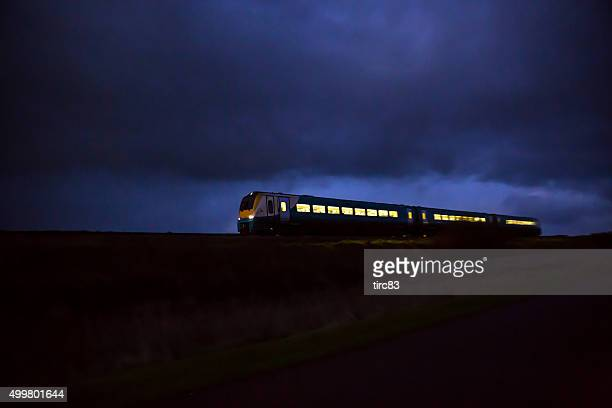 Train travelling at speed by moonlight