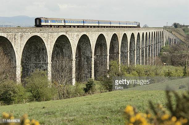 A train travels along Bessbrook viaduct County Armagh Northern Ireland circa 1985