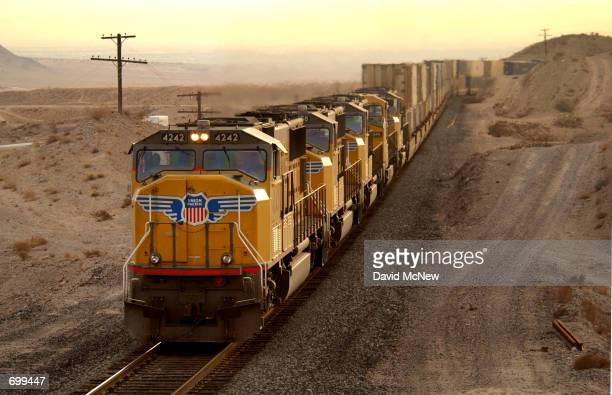 A train travels along the primary proposed route for transporting radioactive waste by rail February 7 2002 north of Las Vegas NV Radioactive waste...