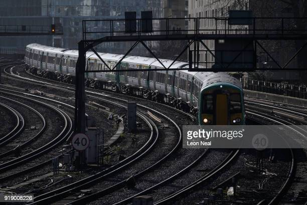 A train travels on the railway tracks near Victoria Station on February 16 2018 in London England