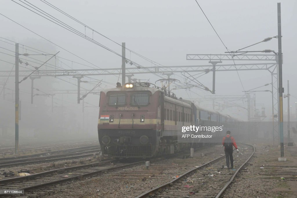 A train travels through dense smog near a railway station in the Indian city of Amritsar on November 7 2017 India`s Central Pollution Control Board...
