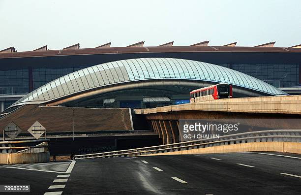 A train undergoes testing on the line leading to the new Terminal 3 of the Beijing Capital International Airport in Beijing on February 21 2008...