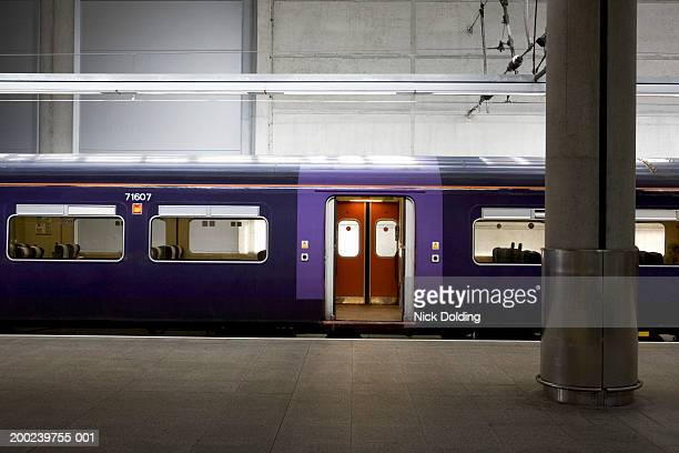 train with doors open, parked at station - vehicle door stock pictures, royalty-free photos & images