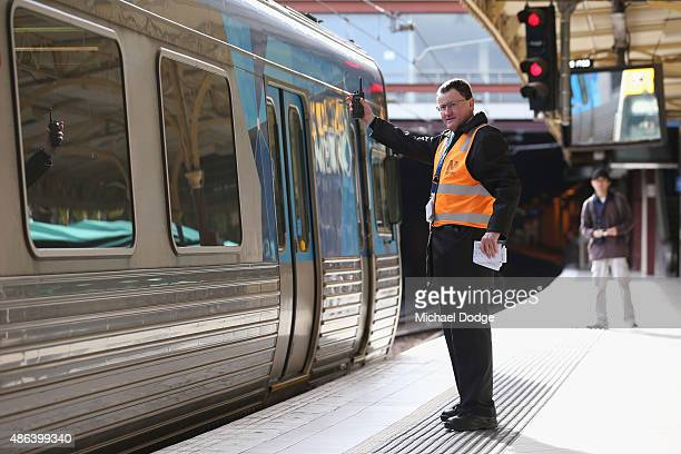 Train workers at Flinders Street Station check empty trains for remaining passengers shortly before Train Union workers start their strike on...