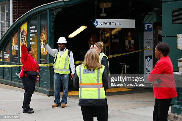 PATH train workers gather outside the station after a New Jersey Transit train crashed into the platform at Hoboken Terminal during morning rush hour...