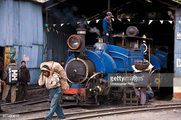 Train workers prepare a steam train for the daily run from Kurseong back to Darjeeling The Darjeeling Himalayan Railway nicknamed the 'Toy Train' is...