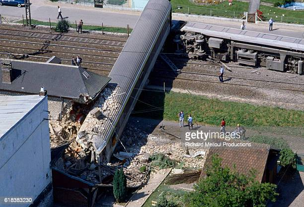 A train wreck blocks the tracks in St PierreduVauvray France Nine people were killed when the train which was traveling from Le Havre to Paris...