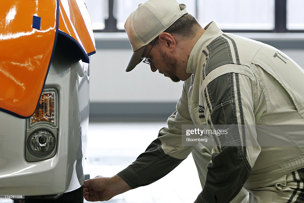 A trainee after-service member of staff works on a Toyota Motor Corp. Prius hybrid vehicle during a maintenance training demonstration at the company's Tajimi service center in Tajimi, Gifu Prefecture, Japan, on Monday, July 22, 2013. Toyota is the world's largest car maker. Photographer: Kiyoshi Ota/Bloomberg via Getty Images