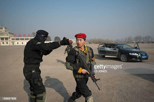A trainee bodyguard of the Genghis Security Academy is reprimanded by instructor Marco Borges following an ambush exercise at an army training ground...