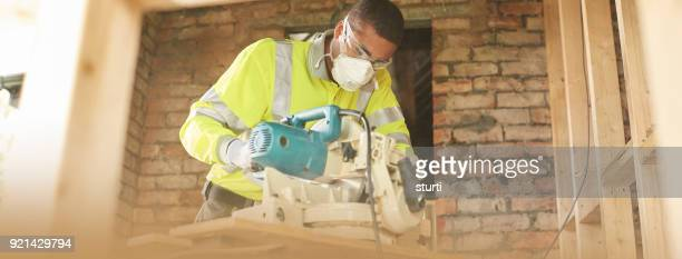 trainee carpenter with chopsaw - foundation make up stock pictures, royalty-free photos & images