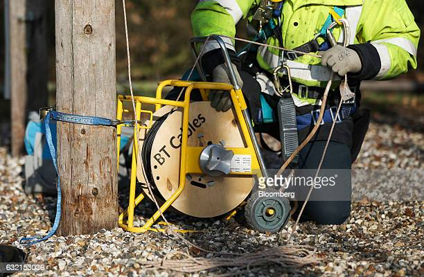 A trainee engineer from BT Openreach a unit of BT Group Plc winds through a section of cabling at the company's training facility at West...