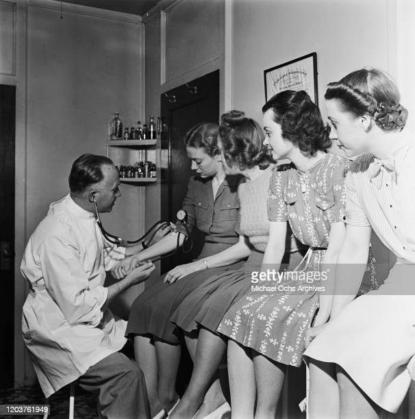 Trainee flight attendants undergo a medical examination at the American Airlines Stewardess College in Chicago, USA, 1939.