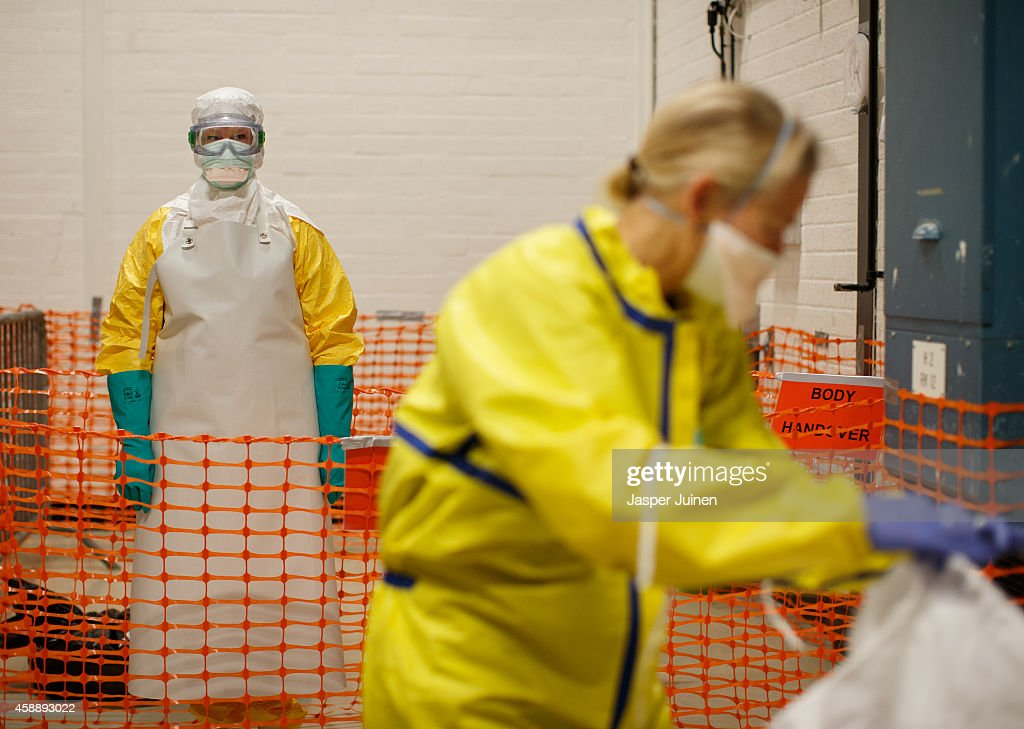 A trainee following the Ebola training program waits to take off her protective suit on November 12, 2014 in Amsterdam, Netherlands. Doctors Without Borders has established a training program in a reproduction field hospital build in an old factory, without electricity and running water, in the Dutch capital for medical personnel world wide who are being sent to countries where Ebola is rife. The charity says it needs hundreds of doctors who are willing and sufficiently skilled to go to Africa to try to help combat the epidemic. The training centre in Amsterdam is the second of its kind after Brussels.