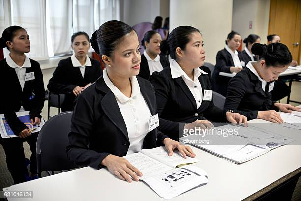Trainee housekeeper Catherine Carrasco front attends a Japanese language class during a training session at the Magsaysay Center for Hospitality and...