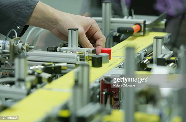 A trainee in mechatronics assembles a test setup at the training center of German car maker Opel AG November 3 2006 in Ruesselsheim Germany In...