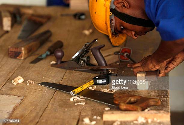 A trainee learns carpentry at L T Construction Skills Training Institute in Panvel India on Wednesday Nov 10 2010 Building companies including Larsen...