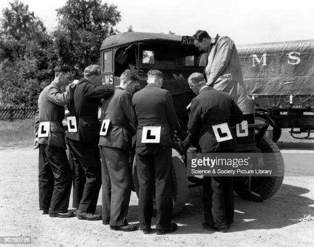 Trainee mechanics of the London Midland Scottish Railway with �L� plates tied round their waists